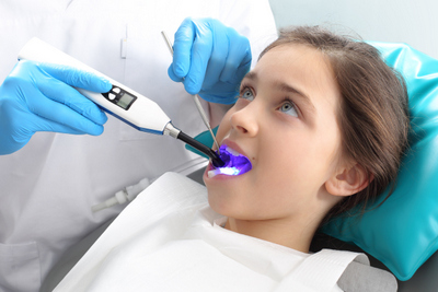 Picture of a kid receiving dental sealants at River's Edge Dental in Great Falls, MT
